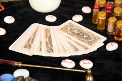 Tarot cards on table. Tarot cards with runes and magical attributes on the table Royalty Free Stock Photos