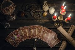 Tarot cards. Tarot cards on fortune teller desk table background. Futune reading concept. Magic mirror and key to the fate Royalty Free Stock Photos