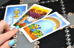 Tarot Cards Three card Spread Ace of Cups The Lovers Ten of Cups. Three card spread displayed on a table.Tarot cards based on the Rider-Waiter system. Ace of royalty free stock photos