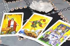 Tarot Cards Three card Spread The Magician The Fool The Chariot. Three card spread displayed on a table.Tarot cards based on the Rider-Waiter system. The royalty free stock images