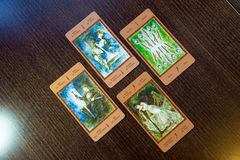Tarot cards on the wood. Labirinth tarot deck. Esoteric background. Moscow, Russia - January 29, 2017: Tarot cards on the wood. Labirinth tarot deck. Esoteric Royalty Free Stock Images
