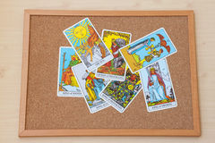 Tarot court cards on the cork board. Queen and King cards. Royalty Free Stock Photography