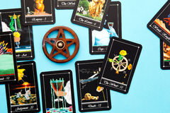 Tarot Deck - Tarot Readings with wooden pentagram incense burner. Tarot readings with deck of Tarot cards with wooden pentagram incense burner on blue background Stock Image
