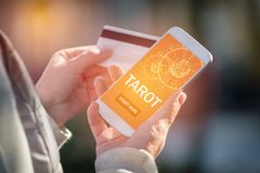 Tarot fortune telling application and credit card Royalty Free Stock Photography