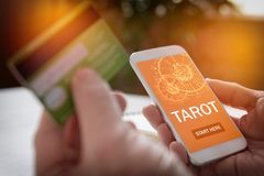 Tarot fortune telling application and credit card Stock Image