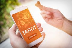 Tarot fortune telling application and crossed fingers Royalty Free Stock Image