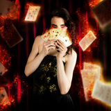 Tarot Magician Holding Magic Fire Cards Of Fate. Creative Fine Art Photo Of A Beautiful Mystic Magician Holding Flaming Cards In A Depiction Of Tarot Fortune Royalty Free Stock Images