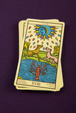 Tarot The Moon. Tarot card The Moon on purple background stock images