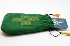 Tarot pack in a green pouch with cross on it Royalty Free Stock Photos