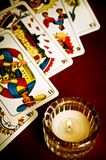 Tarots. Tarot cards with candle on red table Royalty Free Stock Photography