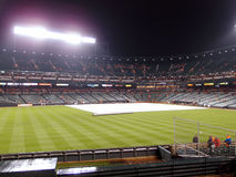 Tarp to cover infield to save it from rain during rain delay Stock Image