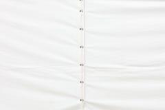 Tarp or waterproof tarpaulin detail background. White tarp or waterproof tarpaulin detail background Stock Photo