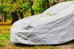 Tarpaulin awning for car. Closeup of car under protective awning from sun, atmospheric phenomena stock photography