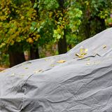 Tarpaulin awning for car. Closeup of car under protective awning from sun and atmospheric phenomena royalty free stock photography