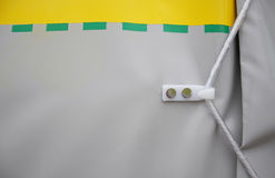 Tarpaulin for truck. Close-up and detail of a plastic tarpaulin for a truck with hook and rope for closing Stock Photography