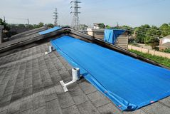 Tarpaulins on roofs Stock Photo