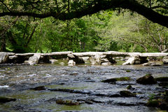 Tarr Steps Exmoor Somerset medieval bridge. Tarr Steps River Barle Somerset. A medieval clapper bridge in Exmoor National Park,  England.   Located in a National Royalty Free Stock Photos
