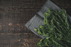 Tarragon on the grey napkin on the wooden table top view Royalty Free Stock Photography