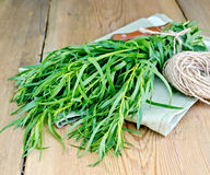 Tarragon with a knife and twine on the board Royalty Free Stock Images
