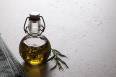 Tarragon oil on a table. With tarragon on the side stock images