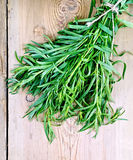 Tarragon on a wooden board royalty free stock photography