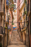 Tarragona narrow street in Spain. Narrow street in Tarragona, Spain, Europe Royalty Free Stock Photography