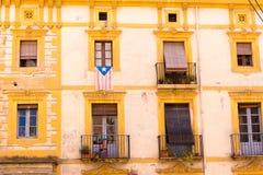 TARRAGONA, SPAIN - MAY 1, 2017: Facade of Spanish house with balconies and flowers. Close-up. TARRAGONA, SPAIN - MAY 1, 2017: Facade of Spanish house with Stock Photo