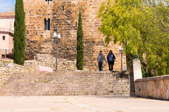 TARRAGONA, SPAIN - MAY 1, 2017: Pensioners are walking around the old town. Copy space for text. Royalty Free Stock Images
