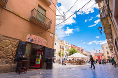 TARRAGONA, SPAIN - MAY 1, 2017: view of the square of the old town and the cafe. Copy space for text. TARRAGONA, SPAIN - MAY 1, 2017: view of the square of the Stock Photography