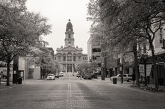 Tarrant County Courthouse. A view of the Tarrant County Courthouse in the distance from a street in downtown Fort Worth, Texas. Built between 1893-1895 and royalty free stock photos