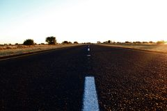 TARRED ROAD AT SUNSET Royalty Free Stock Photography