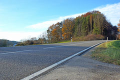 Tarred road. With white lines, trees in the background Stock Image
