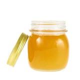 Tarro abierto de la miel aislado Imagen de archivo