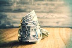 Tarro con el dinero foto de archivo