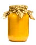 Tarro con la miel aislada Fotografía de archivo libre de regalías