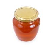 Tarro con la miel aislada en el fondo blanco Fotos de archivo