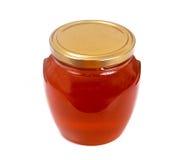 Tarro con la miel aislada en el fondo blanco Foto de archivo libre de regalías