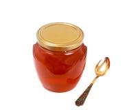 Tarro con la miel aislada en el fondo blanco Imagen de archivo libre de regalías