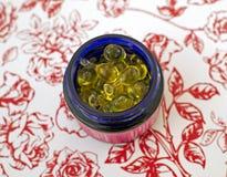 Tarro con las ampollas con aceite Foto de archivo libre de regalías