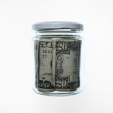 Tarro con las cuentas de dólar Imagen de archivo libre de regalías