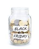 Tarro con las monedas en Black Friday Foto de archivo