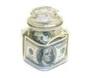 Tarro con los billetes de banco 100$ imágenes de archivo libres de regalías