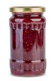 Tarro de cristal con el atasco de frambuesa fotografía de archivo