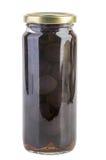 Tarro de cristal con las aceitunas negras imagenes de archivo