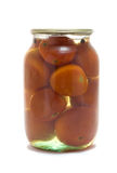 Tarro de cristal con los tomates preservados Fotos de archivo libres de regalías