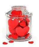 Tarro de cristal llenado de los corazones Fotos de archivo libres de regalías