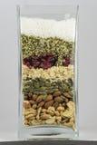 Tarro de cristal por completo de bayas nuts y de comida sana Fotografía de archivo libre de regalías