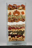 Tarro de cristal por completo de bayas nuts y de comida sana Imágenes de archivo libres de regalías