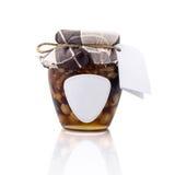 Tarro de la miel con la etiqueta y la etiqueta en blanco Imagenes de archivo