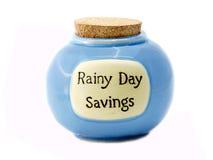 Tarro de los ahorros del día lluvioso Fotos de archivo